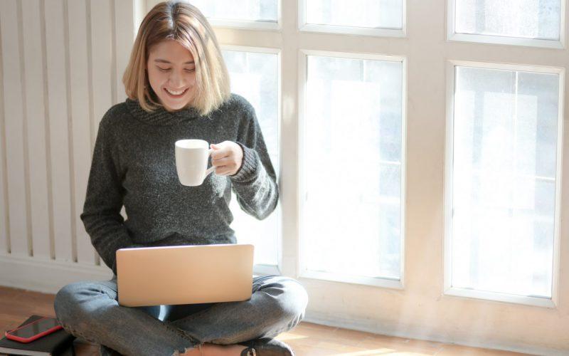 Woman in gray sweater drinking coffee 3759089